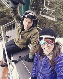 Owners of the Array CBD sitting on a ski lift with goggles and winter gear