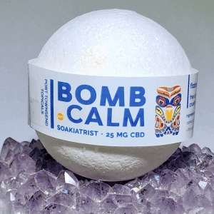 white immune booster bath bomb sitting on a bed of salt rocks